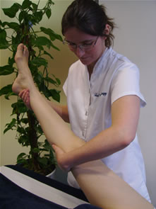 A client's leg is being slowly lowered after a Bowen move has been performed.